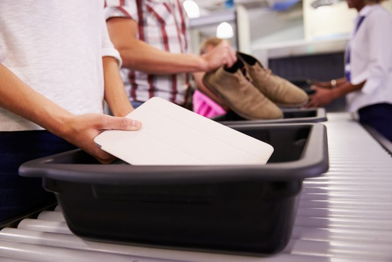 Airport security bins are dirtier than toilets, study shows